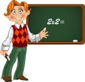 Schoolboy by blackboard. royalty free stock images