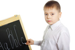 Schoolboy at blackboard Stock Image