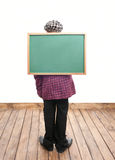 Schoolboy with blackboard Stock Images