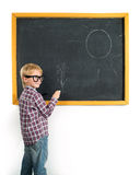 Schoolboy and blackboard Stock Images