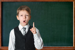 Schoolboy at the blackboard Stock Photo