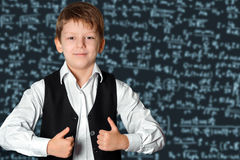 Schoolboy at the blackboard Royalty Free Stock Images