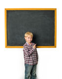 Schoolboy and blackboard Stock Photos