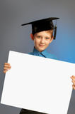 Schoolboy with blank paper Royalty Free Stock Photography