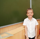 Schoolboy before a board Royalty Free Stock Photos