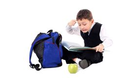 Schoolboy with book and apple Stock Photography
