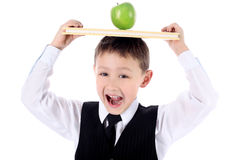 Schoolboy with book and apple Royalty Free Stock Photography