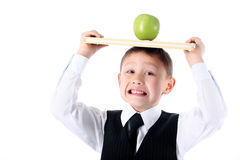 Schoolboy with book and apple Stock Images