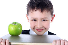 Schoolboy with book and apple Royalty Free Stock Photo