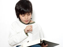 The schoolboy with book in hands Stock Photo
