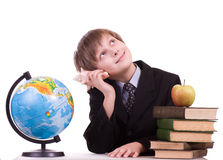 Schoolboy with books, globe and apple Stock Photography