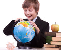 Schoolboy with books, globe and apple Royalty Free Stock Photo