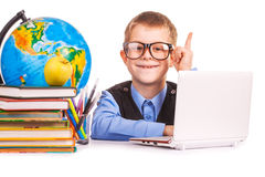 Schoolboy with books and laptop on a white Stock Photo
