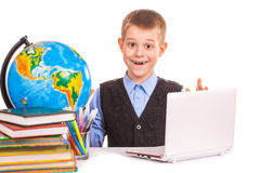 Schoolboy with books and laptop  Royalty Free Stock Photo