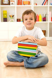 Schoolboy with books sitting on the floor Royalty Free Stock Photo