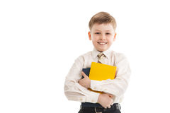 Schoolboy with a books smiles isolated Stock Photos