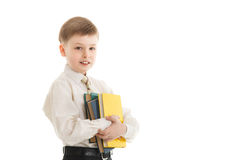 Schoolboy with a books smiles isolated Royalty Free Stock Photos