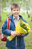 Schoolboy with a bouquet in the park Royalty Free Stock Image