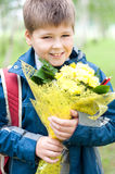 Schoolboy with a bouquet in the park Stock Photo
