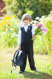 Schoolboy with a bouquet at 1st of September Stock Images