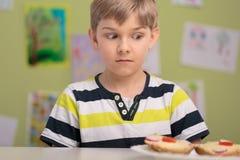 Schoolboy with breakfast at school Stock Photo