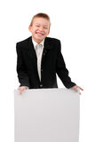 Schoolboy with broadsheet. Cheerful boy with blank broadsheet isolated on the white Royalty Free Stock Image