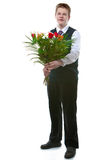 The schoolboy with a bunch of flowers Royalty Free Stock Image