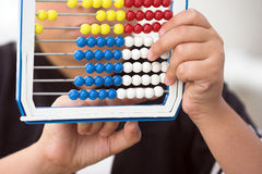Schoolboy calculate with abacus Stock Photos