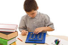 Schoolboy with calculator Royalty Free Stock Images