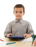 Schoolboy with calculator Royalty Free Stock Image
