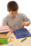 Schoolboy with calculator Stock Image