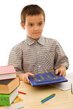 Schoolboy with calculator Royalty Free Stock Photo