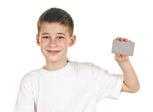 Schoolboy with card. Portrait of happy schoolboy with card on white background Royalty Free Stock Image
