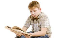 Schoolboy carefully reading a book. On white background schoolboy carefully reading a book stock image