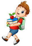 Schoolboy carrying books and apple. Illustration of Schoolboy carrying books and apple Royalty Free Stock Photo
