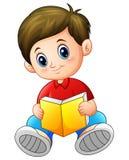 Schoolboy cartoon reading a book Stock Image
