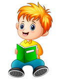 Schoolboy cartoon reading a book Royalty Free Stock Image