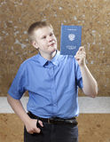 Schoolboy with the certificate about completion of education at school.  royalty free stock image