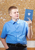 Schoolboy with the certificate about completion of education at school Royalty Free Stock Photos