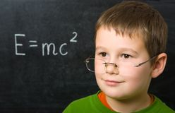 Schoolboy at the chalkboard Royalty Free Stock Images