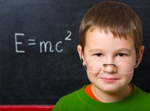 Schoolboy at the chalkboard Royalty Free Stock Photos