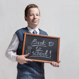 Schoolboy with chalkboard - back to school Royalty Free Stock Images