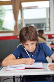 Schoolboy Cheating At Desk During Examination Stock Images