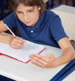 Schoolboy Cheating During Examination Royalty Free Stock Photos