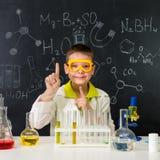 Schoolboy in chemistry lab got an idea Royalty Free Stock Photo