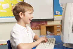 Schoolboy In IT Class Using Computer Stock Image