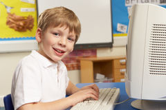 Schoolboy In IT Class Using Computer Royalty Free Stock Photography