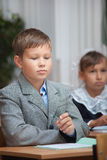 Schoolboy in classroom Royalty Free Stock Image