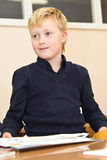 Schoolboy in the classroom Stock Photo