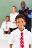Schoolboy in classroom. Elementary schoolboy in front of teachers and classmate in classroom Stock Photo